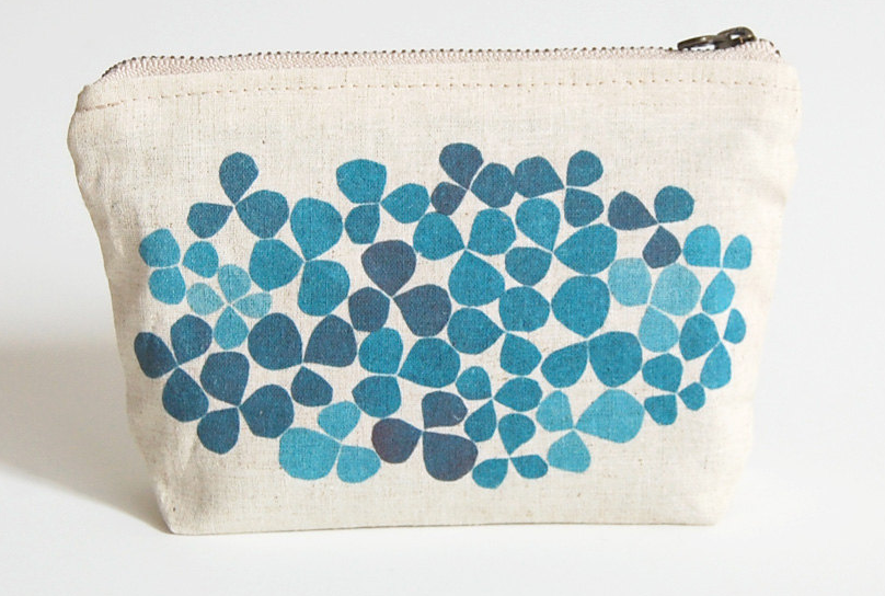 A small handmade pouch printed by the maker with an abstract 'pebble' design in various blues.